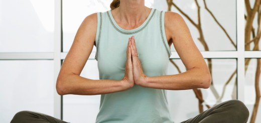 Woman with eyes closed in yoga position