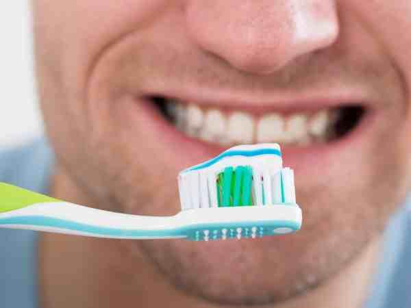 Closeup of mid adult man brushing teeth