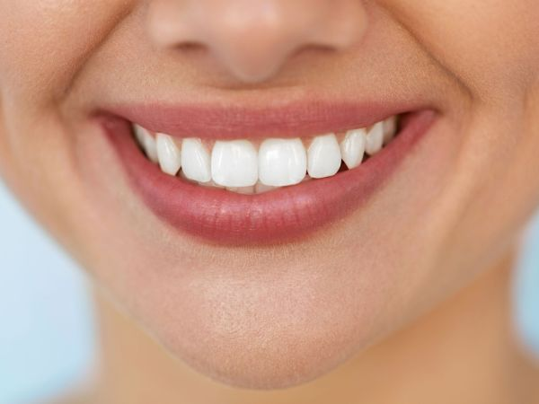 Beautiful Smile With White Teeth. Closeup Of Smiling Woman Mouth With Natural Plump Full Lips And Healthy Perfect Smile. Teeth Whitening, Dental Health And Lip Care Concepts. High Resolution Image