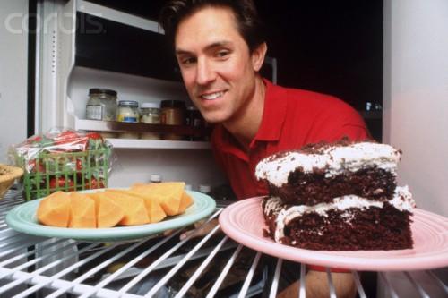 Man Deciding on Snack --- Image by © Roy Morsch/CORBIS