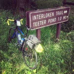 Bicycle parked at a trail sign for the Interloken Trail