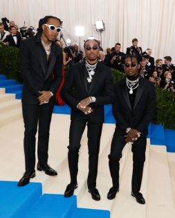 Takeoff, Quavo and Offset of the group Migos in Versace