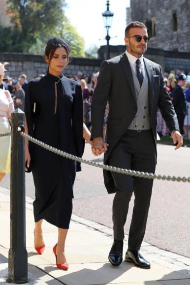 Victoria and David Beckham wearing a Victoria Beckham dress and Dior Homme suit.