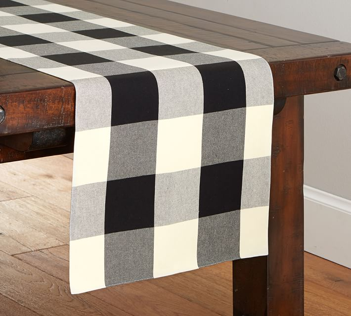 Who else is obsessing over everything buffalo check! We're sharing our favorite black and white plaid looks for Christmas! | Pottery Barn Table Runner