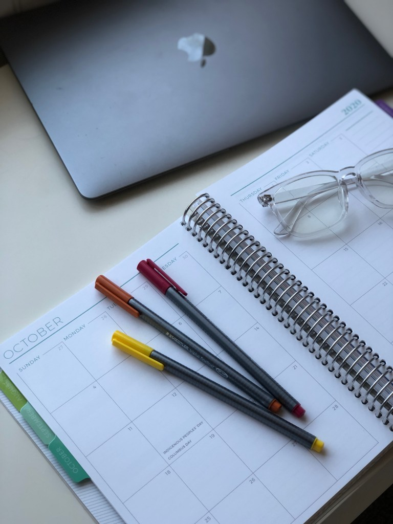 Planning essentials! You'll need the perfect planner - we love Plum Paper. Plus pens, and blue light blocking glasses!