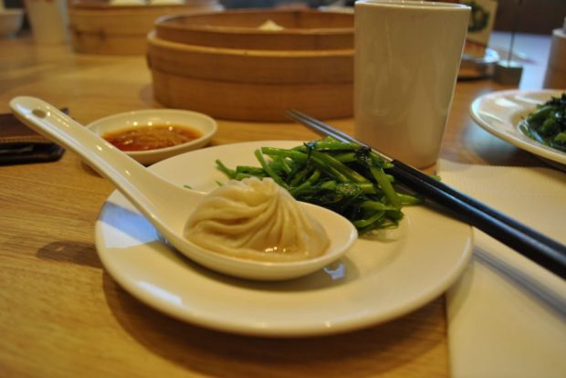 It's a soup, it's a dumpling...it's everything you could ever hope for in a mouthful. Your sauce is a 3:1 mix of white vinegar and soy sauce. We got water spinach as well, in the background, currently drooling.