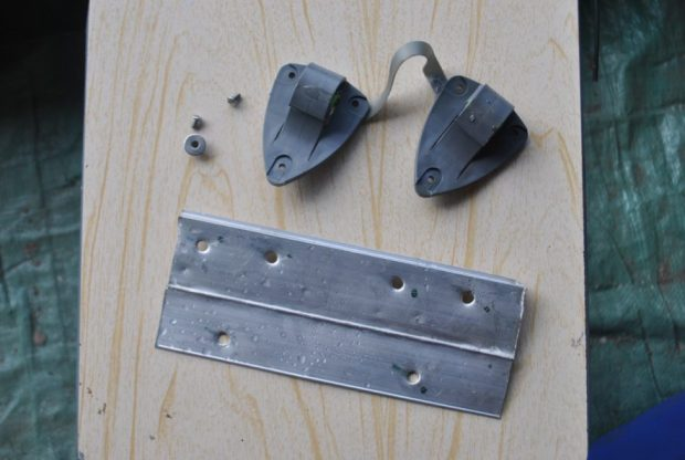 Aluminum for reinforcing the pannier hooks. One set of hooks pictured.