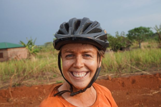 a photo of me with red dirt on my face smiling in Uganda