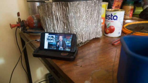 John Oliver video playing on iphone on the table of a Tanzanian guesthouse