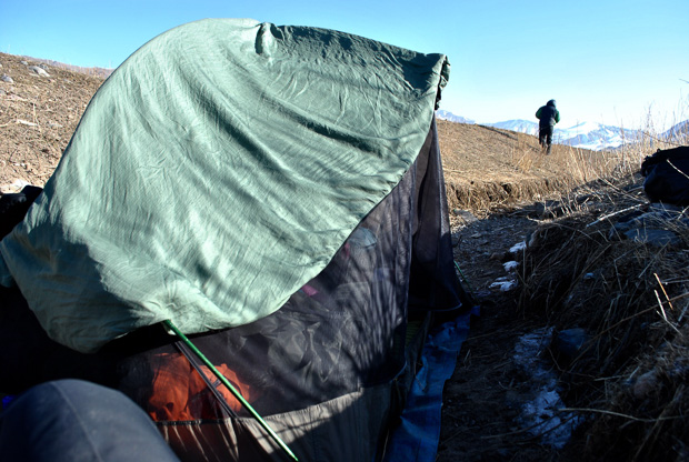 a silk sleeping bag liner drying in the morning sun on top of an msr hubba hubba tent in Kyrgyzstan
