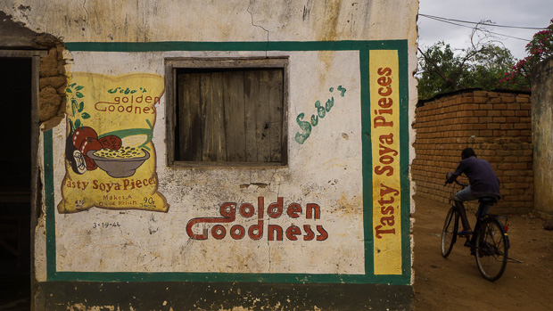 Handpainted mural on a building in Malawi advertising soya pieces