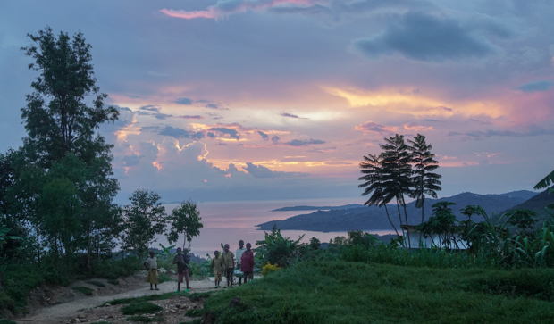 Rwandan children at sunset over Lake Kivu on the Congo-Nile Trail