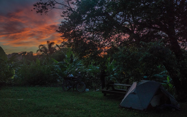 sunrise over Mabuda Farm campsite with our tent set up beside a picnic table, at Siteki Swaziland