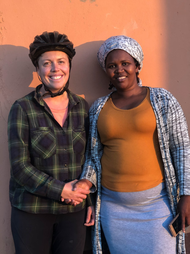 nolondo a xhosa woman and I shake hands in the early morning light