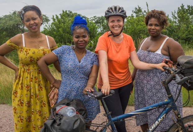 me with three fashionable women from swaziland posing together with my bicycle at the Mozambique Swaziland border