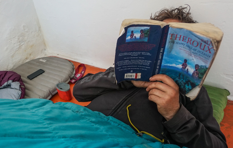 evan on his air mattress reading happy isles of oceania by paul theroux