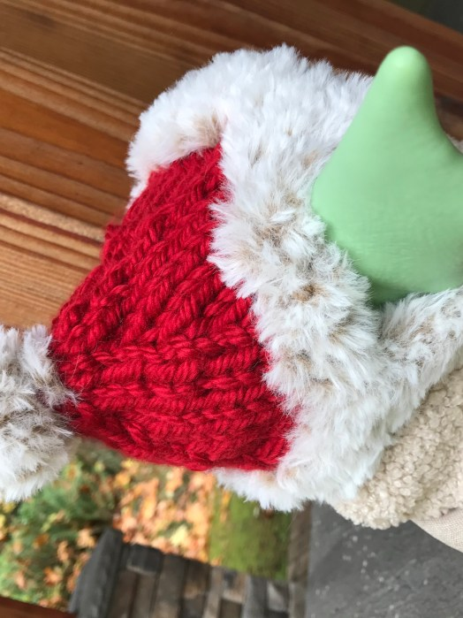 back of baby yoda's head and santa hat