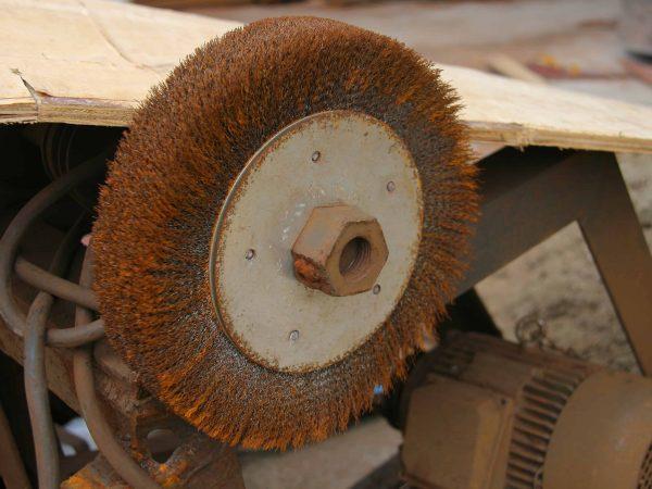 34505842 – rusty burnishing machine in an old factory