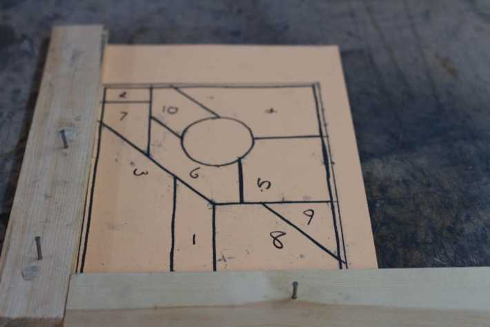 Photo of a template for making a small stained glass window. Sections are numbered. Stained glass workshop in Fife