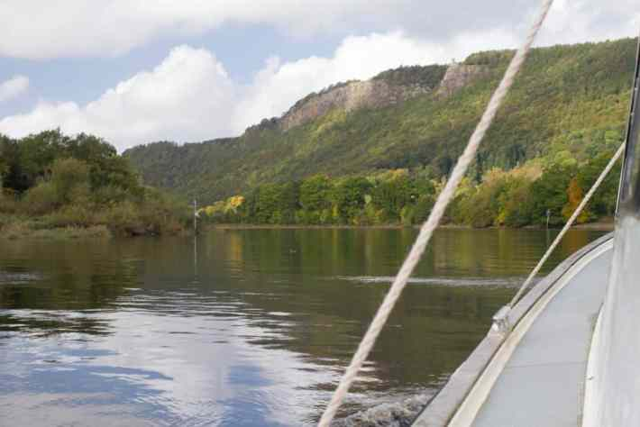 River boat trips, Perthshire, Scotland. Photo of the side of the boat facing out on to the water and hills in front