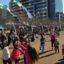 kids playing with bubbles in park