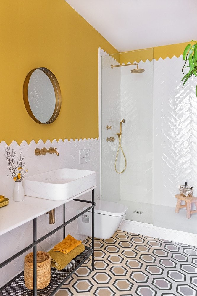 mustard, hexagonal tiles, mustard walls, herringbone tiles, gold shower accesories, bathroom