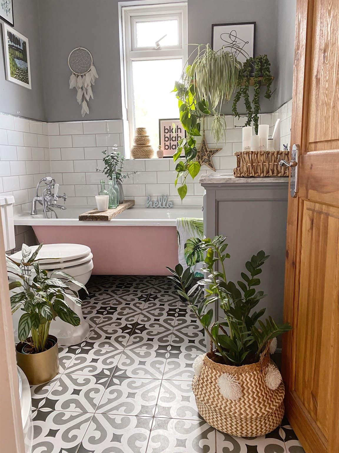 plants, bathroom, tiled floor, pink bath