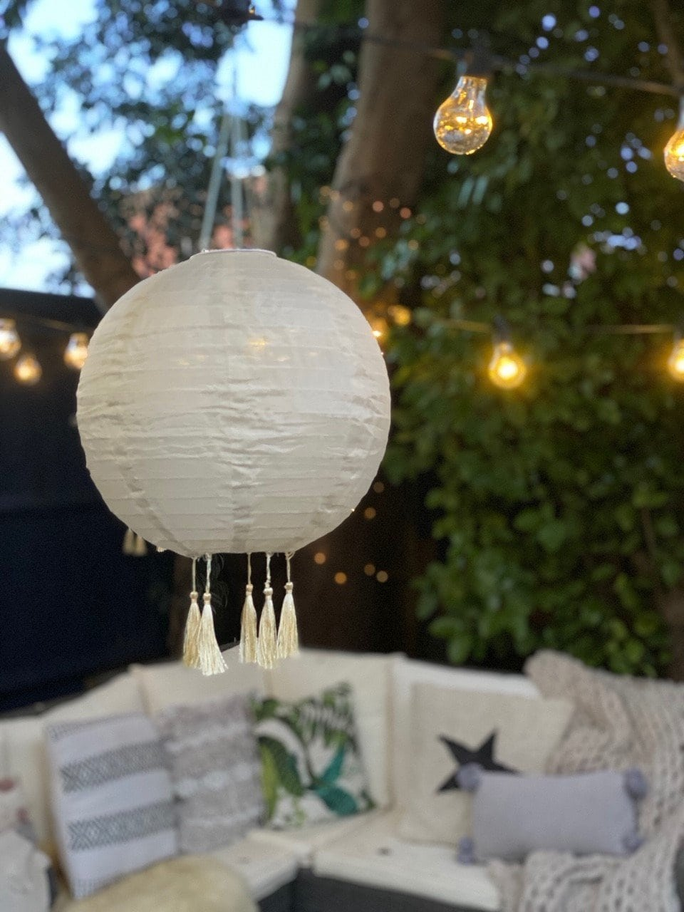 garden, garden inspiration, back yard, yard, patio, gravel, festoon lights, outdoor furniture