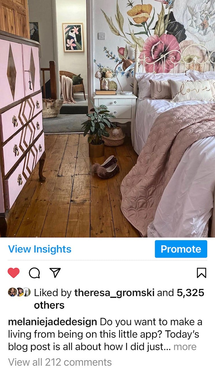 melanie jade design instagram post of guest bedroom with floral wall mural and bed.