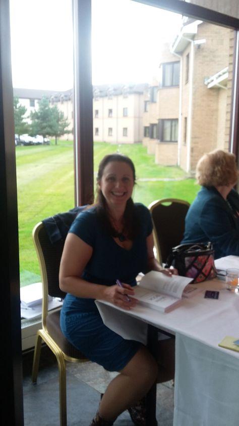 Joanna Penn signing a book