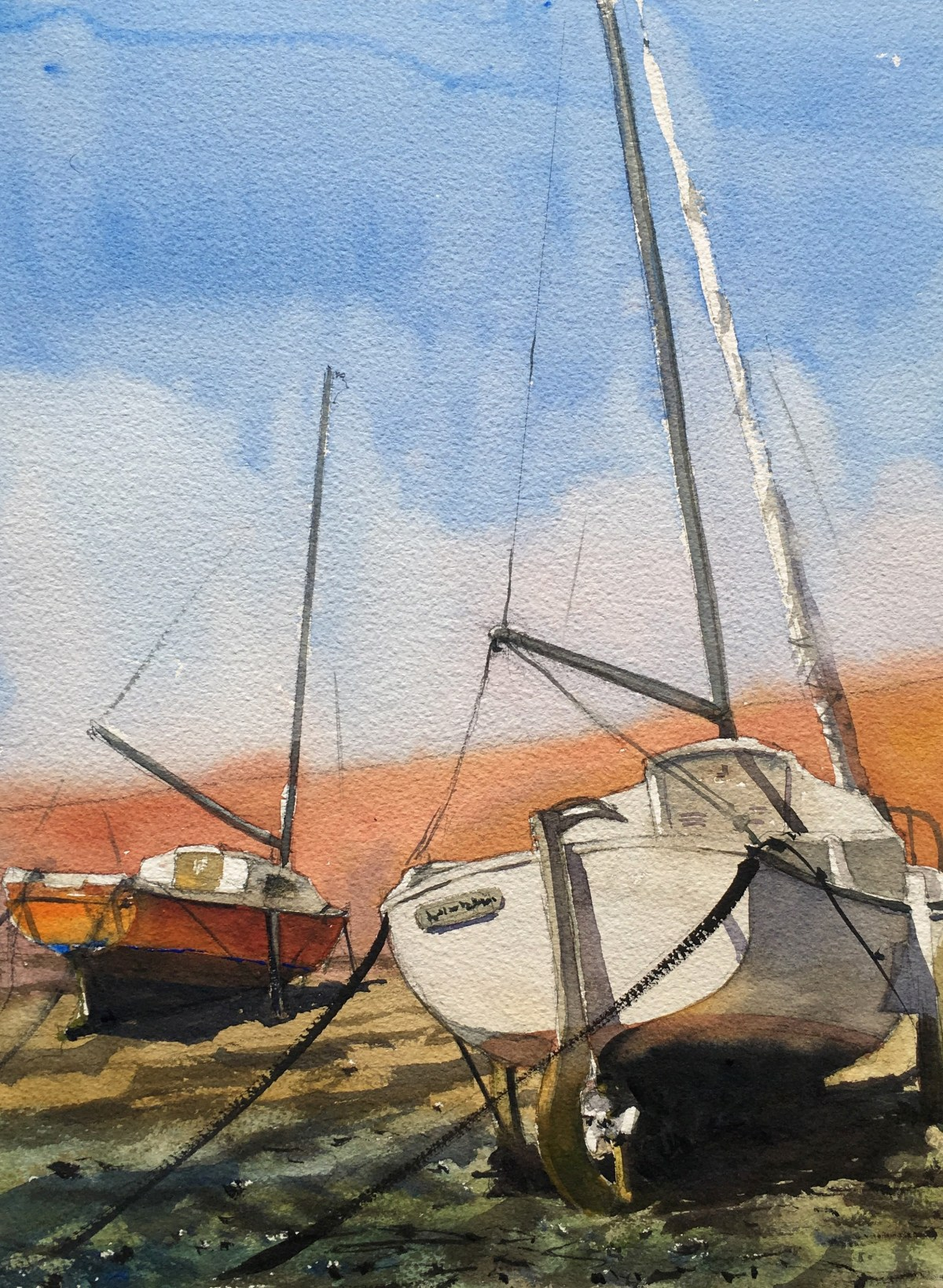 Two sailing boats on dry land on a hot day