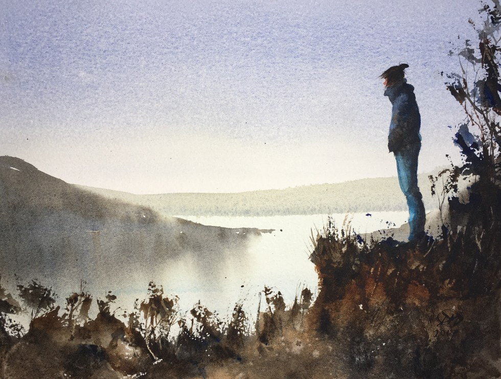 Woman looking out on winter archipelago