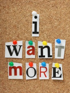 The phrase I Want More on a cork notice board