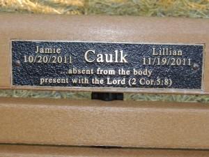 Memorial bench dedicated to Jamie and Lillian Caulk in Saline, MI