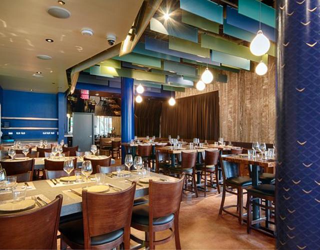 Interior of Chef Ricardo Zarate's Paiche LA Restaurant, custom column mural by Melissa Judson.