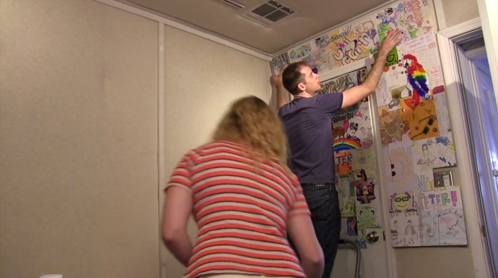 Nice Peter helps to install his new Monday Show Background collage of viewer mail created by Melissa Judson