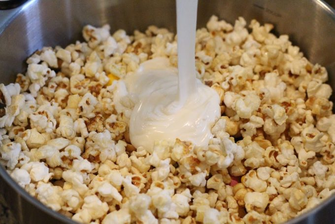 Popcorn in a bowl with white chocolate