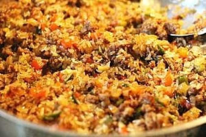 a skillet with Cajun Dirty Rice