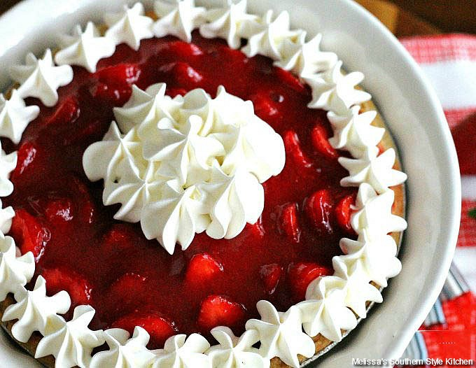 Fresh Strawberries and Cream Pie on pie stand