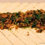 sausage and spinach on crescent roll dough