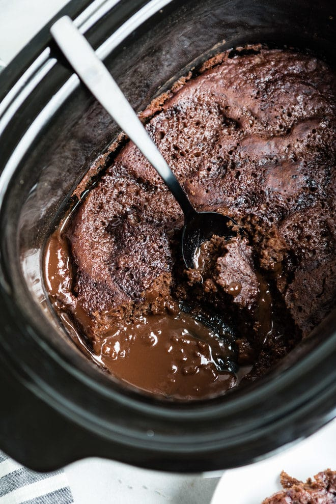 chocolate lava cake with a spoon in a slow cooker