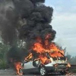 Auto in fiamme sull'Asse Mediano