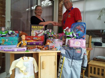 Melksham Lions made a donation of toys to Melksham Helping Your Own