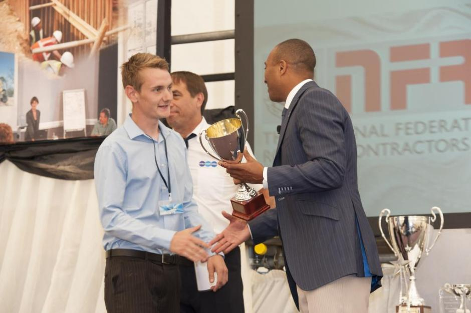 Josh receives his roofing apprenticeship award from Colin Jackson