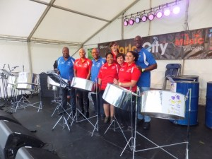 The Melodians Steel Orchestra was the opening act for the festival at Osterley on Saturday 28th June.  In spite of the heavy rain the crowds came out and danced to the exciting beat of the Melodians.  This was a great start to the weekend of World music.