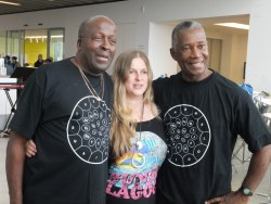 Terry Noel (Leader of Melodians), Em Peasgood (Composer/Arranger for Big Sing choir), Robert Thompson (Composer/Arranger) visiting from Trinidad to work with the Melodians). Melodians T shirts designed by Jeremy Deller for the Melodians.