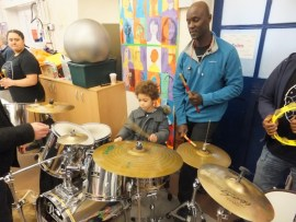 Michael teaching the drums.