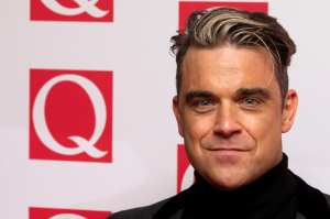 Robbie Williams @ Q Awards 2013 © ANDREW COWIE/GettyImages