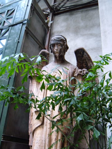 angel statue with a plant