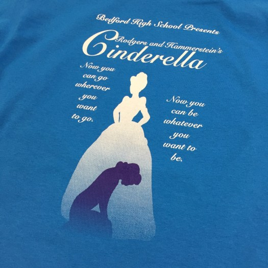 Printed t-shirt: Cinderella logo with kneeling Cinderella in front, Standing ball gown Cinderella behind